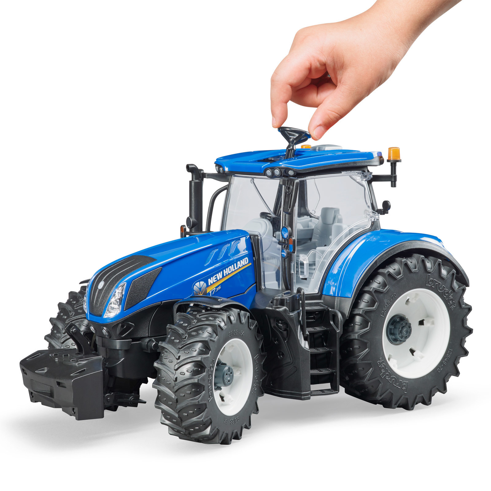 BRUDER Kinder Spielzeug Traktor New Holland T7.315 | real